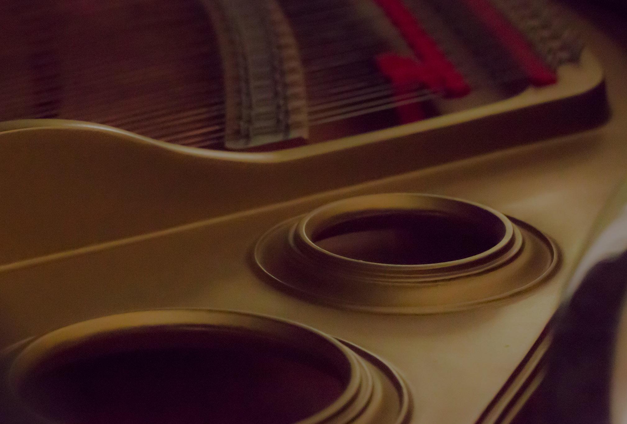 close up of piano strings
