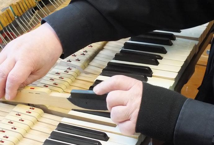 repairing a piano key